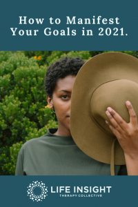 A graphic with a woman holding a hat in front of her face with greenery in the background representing how you can benefit from meeting with a La Grange life coach.